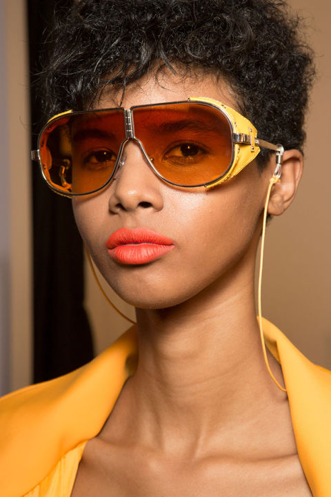 A peachy orange lipstick to coordinate with the collection backstage at Versus.