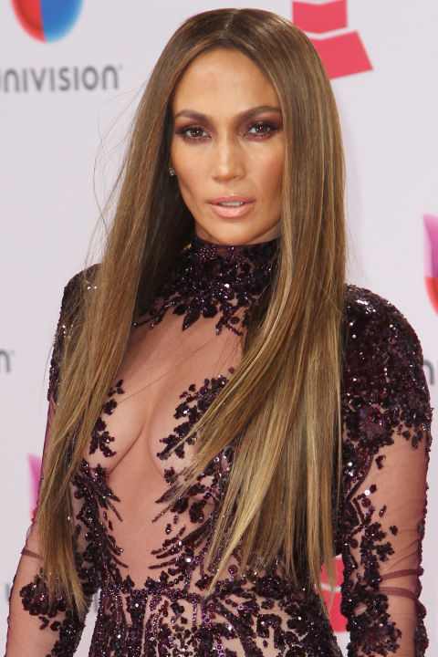 Who: Jennifer Lopez<br />What: Sleek Hair<br />How: If this picture didn't immediately make you fish out and heat up your flat iron, then we don't know what will. At last night's Latin Grammy Awards, Jennifer Lopez counted on hairstylist Chris Appleton for his signature sleek, ultra-long hairstyle. Straight hair that looks glossy—not fried—requires the right tools and key products (so, not your 10-year-old flat iron). First, prep wet hair with a styling cream that will fight frizz and leave hair shiny. After blowdrying, Appleton regularly uses a GHD iron to get each section straight and sleek. Once your hair has been ironed, go ahead and mist it with a lightweight finishing oil to bump up the shine-factor and quell any rogue flyaways.<br />Editor's Pick: L'Oréal Paris Blow Dry It Thermal Smoother Cream, $4.99, ulta.com<br />