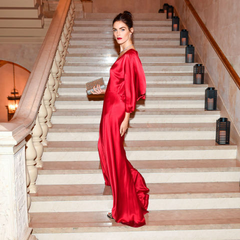 Make a serious entrance in a floor-sweeping red gown. Gleaming silver extras add to the allure.
