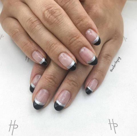 For nail art that feels modern yet minimal, choose a double dipped black and silver tip.@nailartbysig
