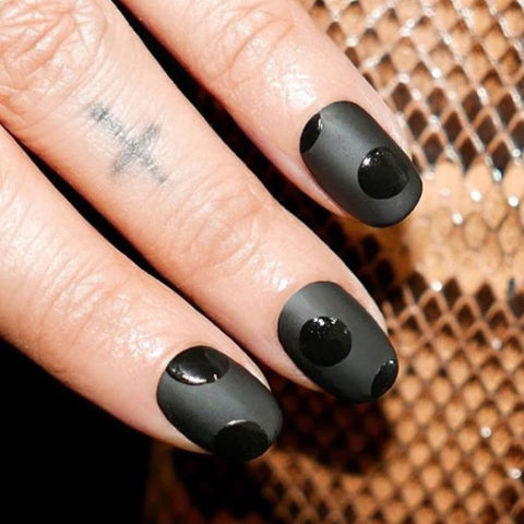 Mix matte and glossy finishes for a not-so-basic black manicure.@aliciatnails