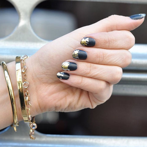 Brighten up a matte black base with imperfectly placed gold foil.@paintboxnails