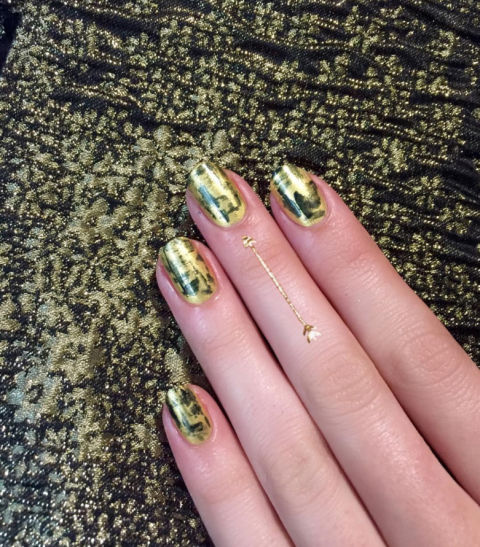Layer gold and black pearl-infused polishes for an opulent, abstract look.@jinsoonchoi