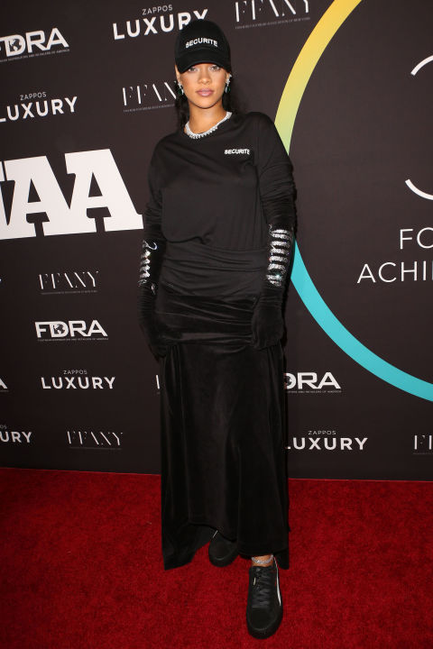 In Fenty x Puma creepers, a Securite basebal cap and long sleeve tee, velvet skirt, velvet gloves and Chopard jewels at the 30th annual FN Achievement Awards in NYC.