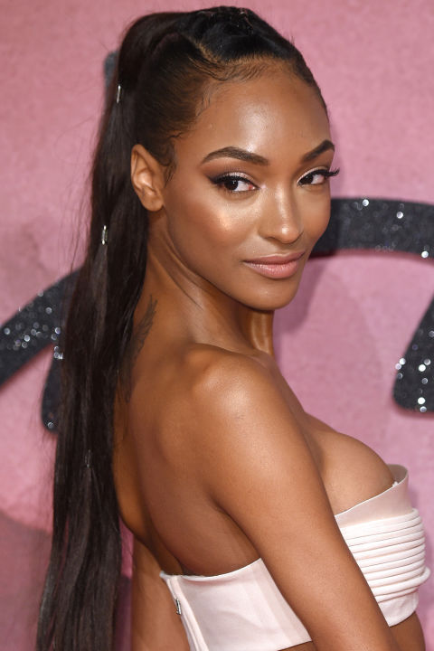 You could just highlight your cheekbones and be done with it. But why stop there? Take a cue from Jourdan Dunn and sweep the brush along the bridge of your nose, across your forehead, and down each shoulder.