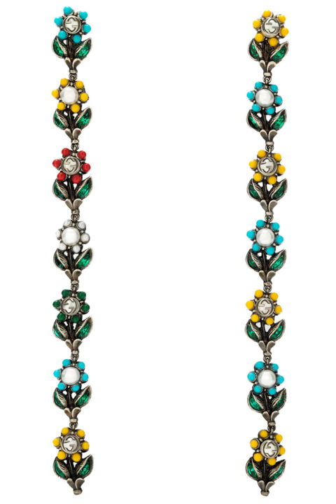 """""""Working in the jewelry market, I tend to invest in fine pieces when I buy for myself, but with so many fun bold, statement earrings available now I'm ready to change up my game plan."""" Gucci earrings, $780, shop.harpersbazaar.com."""