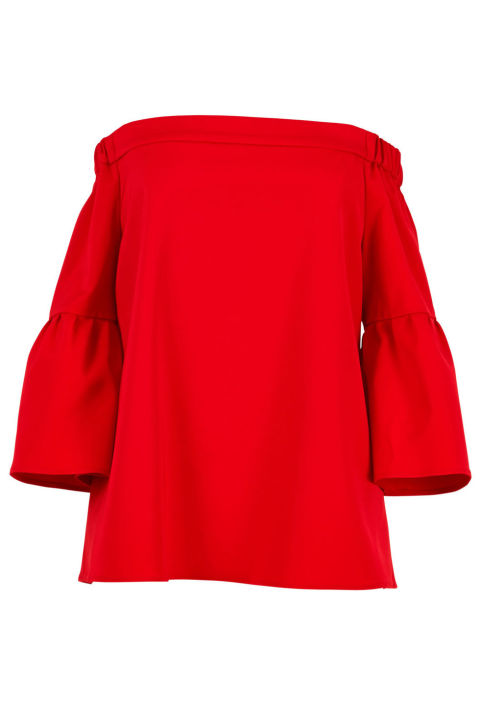 """""""Anything in black is always my go-to, but my closet is starting to feel flat with too many pieces in the same staple color. My style resolution for 2017 is start buying shapes I know I love, but in brighter shades. This off-the-shoulder top in a punchy red is calling my name."""" Tibi top, $285, shop.harpersbazaar.com."""