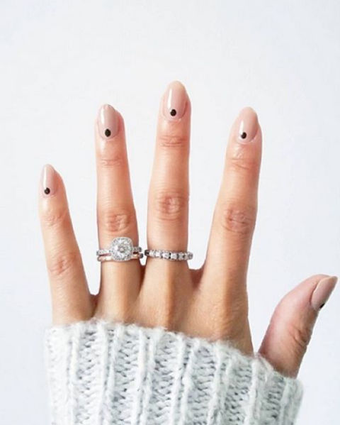 Manicure minimalists: a petite dot at the base of the nail is easiest way to experiment with nail art. @deborahlippmann