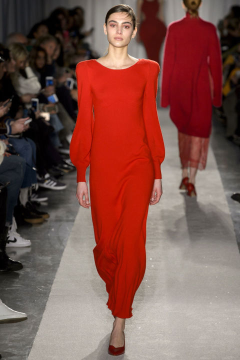A strong shouldered subdued take on an '80s shoulder was a standout on a cherry red knitted maxi dress. This collection is chic comfort at its best.