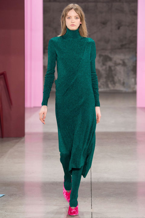 Smilovic kept her shapes and silhouettes roomy and long, but not frumpy. A pair of shiny turtleneck dresses clung, hung and swung saucily, and were paired with matching leggings and velvet pumps. The color combo of green dress and shocking pink pump was especially fun. But interesting color play is also a Tibi signature.