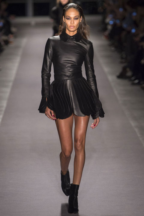 Brandon Maxwell didn't waste time. His first look out was a black leather mini on Joan Smalls. Legs for days countered by long sleeves—also black leather— and a covered-up schoolgirl collar and a sweet layered scalloped hem. Fierce, confident, feminine, smart.