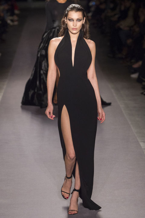 "Maxwell likes to go big just as much as he likes to go body-skimming, showing a sweeping ballgown, dramatically in all black. But not before Bella Hadid sizzled along in a floor-length gown that screamed ""bombshell."""