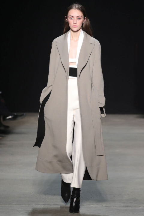 Rodriguez kept coat silhouettes long and fluid with unstructured shoulders and collars and pants at a cropped length—the better to show off pointy-toed booties in matching gray, winter white, pumpkin and black tones.
