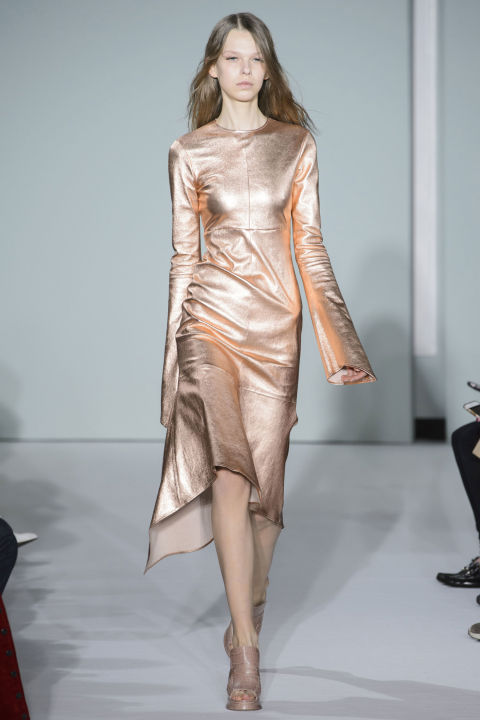 The designer also played in metallics, like this rose gold leather dress, fitted to perfection, with ultra long sleeves for added interest.