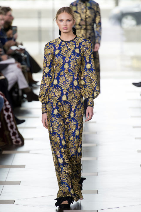 Burch completed her Fall story with a range of embroidered gowns, the star of which was a bold blue and gold long-sleeved maxi dress—because sometimes a woman just wants to put on a beautiful dress.