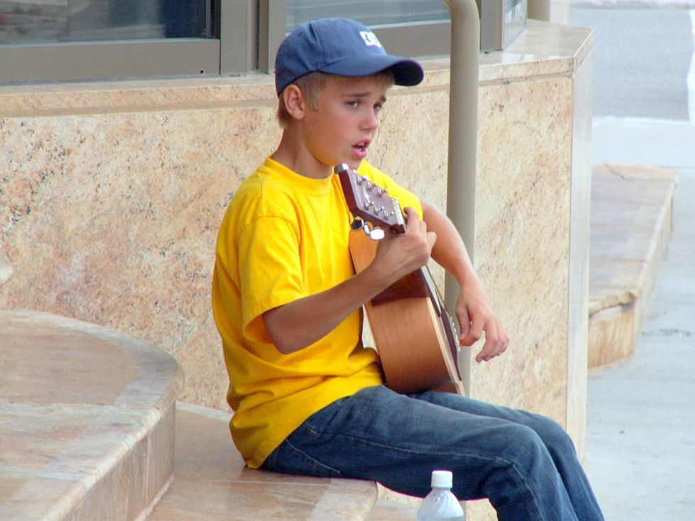So it isn't exactly a professional performance, but this picture of a young Justin Bieber singing on the street in Canada circa 2007 will make you yearn for his