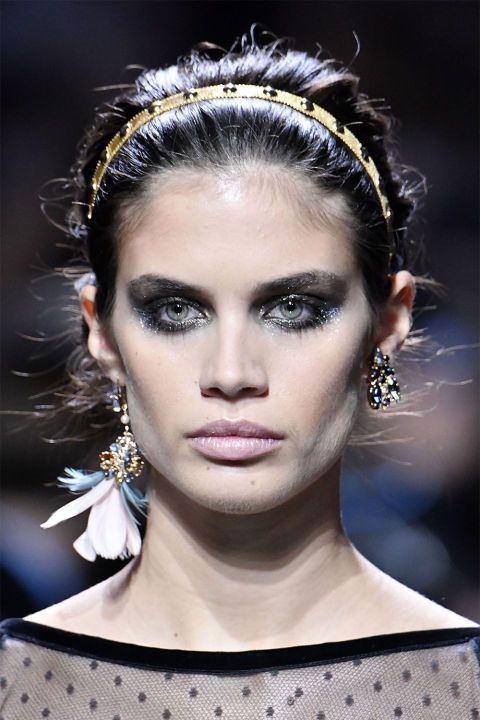 If we were rating looks from a little to a lot—blacksmoky eyes with a layer of glitter would be considered a lot of look. But something about the way Tom Pecheux expertly blended the liner and shadow around the eyes, then tapped on two different microglitter pigments in silver and gold, made the eyes at Elie Saab seem delicate, feminine, and even soft. These were not disco eyes, or clubbing eyes—they were eyes fit for a spookierside of classicromance (the collection was inspired byGiselle, after all).