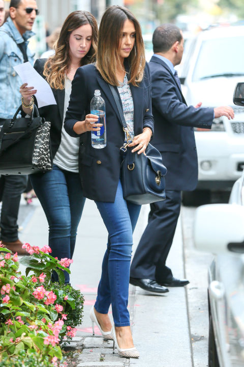 Jessica Alba looks polished and ready for business in a pair of slim jeans and double-breasted blazer with a Ralph Lauren Collection bucket bag.