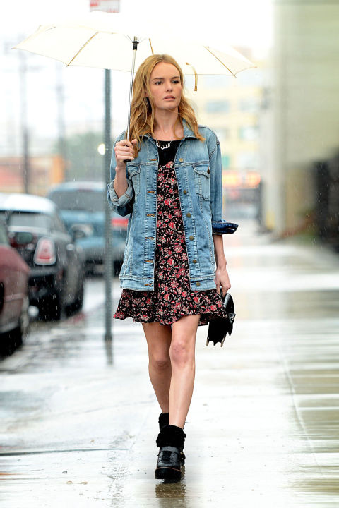 Kate Bosworth combats a rainy day in L.A. by throwing a Guess denim jacket over her floral sundress.