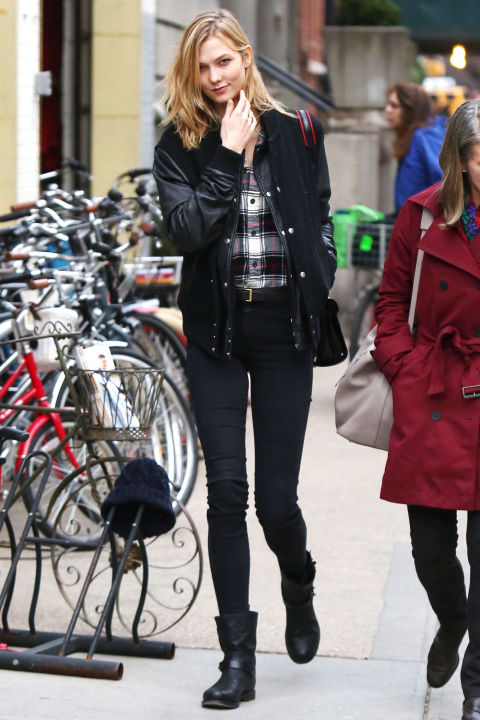 Model Karlie Kloss hits the New York streets with a cool bomber jacket, skinny jeans and Rag & Bone boots.