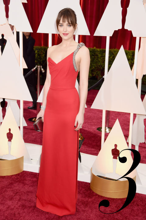 Red room, red dress? The Fifty Shades of Gray starlet nailed her big moment in a sultry yet chic embellished crimson one-shouldered gown by Saint Laurent.