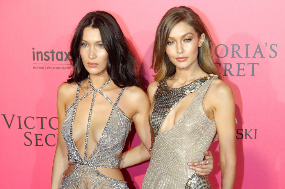 The only thing shinier than the Hadid sisters dresses are their killer cheekbones.